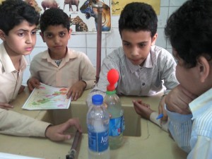 Primary grade Arab science students at work